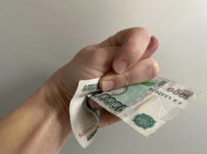 Рука с деньгами